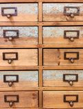 Closeup wood chest of drawers vintage look Stock Image