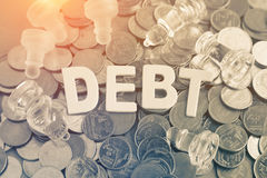 Closeup wood letters of debt Royalty Free Stock Photos