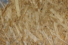 Closeup of a wood particle board with a stain of silver paint in the corner. As a background stock images