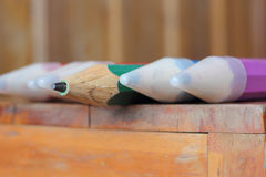 Closeup wood pencils on wooden table Royalty Free Stock Photo