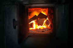 Closeup of  wood stove with the burning firewood. Royalty Free Stock Image