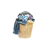 Closeup wood weave basket for used clothes with pile of clothes in house isolated on white background Stock Photo