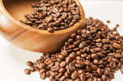 Closeup of Woodden Bowl with Heap of Arabica Coffee Beans on Whi Stock Photo