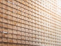 Closeup wooden blind textures with yellow sunlight in cafeteria. stock photo