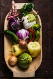 Closeup of  wooden bowl with fresh vegetables Royalty Free Stock Photography