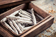 Closeup of wooden box with cigarettes Stock Images