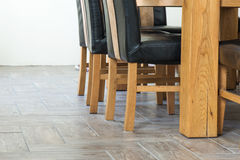 Closeup of wooden chairs and table legs Royalty Free Stock Photo