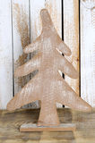 Closeup wooden Christmas fir tree. On wooden background Royalty Free Stock Image