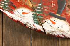 Closeup of wooden decoration: star and snowman with top hat Stock Photography