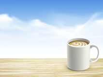 Closeup of wooden desk and coffee over blue sky Royalty Free Stock Image