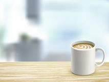 Closeup of wooden desk and coffee in room Royalty Free Stock Images