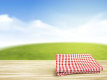 Closeup of wooden desk and tablecloth over blue sky Stock Photography