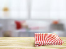 Closeup of wooden desk and tablecloth in room Stock Image