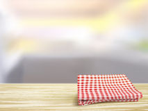 Closeup of wooden desk and tablecloth in room Royalty Free Stock Image
