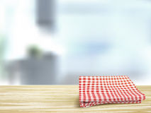 Closeup of wooden desk and tablecloth in room Royalty Free Stock Photos