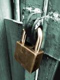 Closeup wooden door with lock. Lock door closeup rust rough dirty Stock Photo