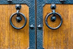 Closeup of wooden door with metal door handle Stock Image
