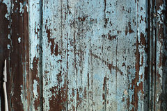 Closeup of a Wooden Door with Peeling Blue/Teal Paint Royalty Free Stock Photography