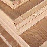 Closeup of wooden doors. Closeup of workshop production of wooden doors on modern factory Royalty Free Stock Photos
