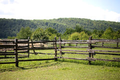 Closeup of wooden fence on a corral farmland rural scene. Old wooden corral fence in meadow rural scenic Royalty Free Stock Photography