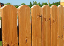 Closeup on wooden gate ( wicket ) and wooden fence detail construction with doorway outdoor. Textured Background Royalty Free Stock Images
