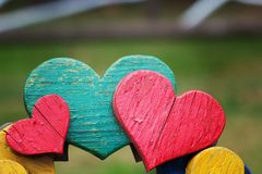 Closeup of wooden hearts on bench in outdoor stock image