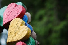 Closeup of wooden two hearts on bench in outdoor stock image