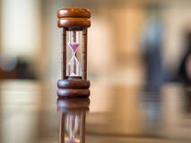 Closeup wooden hourglass on the table, Royalty Free Stock Photography
