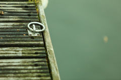 Closeup of wooden pier and lake water. Closeup macro of wooden pier and lake water Royalty Free Stock Images