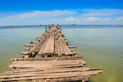 Closeup Wooden Pier Stretches Far Away to Azure Ocean Royalty Free Stock Photos