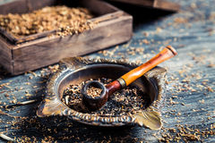 Closeup of wooden pipe with tobacco Stock Photo