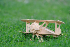 Closeup wooden plane toy on grass Stock Image