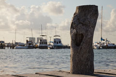 Closeup of wooden post on pier. Closeup of  the wooden post and fishing boats on the background Stock Photography