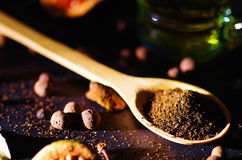 Closeup wooden rustic spoon filled up with fresh herbal tea powder, other teas and spices in background, very nice Stock Photos