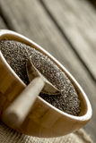 Closeup of wooden spoon in small wooden bowl full of healthy nut Stock Photography