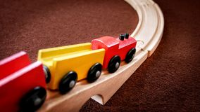 Wooden Train Toy Moving Down the Bridge. Closeup Wooden Train Toy Moving Down the Bridge Royalty Free Stock Photo