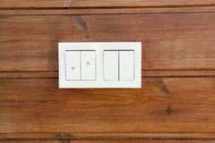 Closeup of wooden wall with light switch. Royalty Free Stock Photo