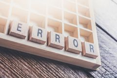 Closeup Of The Word Error Formed By Wooden Blocks In A Type Case. A Closeup Of The Word Error Formed By Wooden Blocks In A Type Case stock photo
