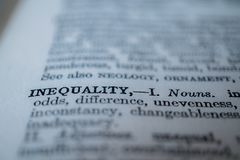 Closeup of the word inequality. Closeup of the thesaurus or dictionary definition of the word inequality royalty free stock photo