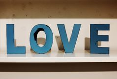 The word love out of wooden letters. Closeup of the word love out of wooden letters Stock Image