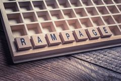 Closeup Of The Word Rampage Formed By Wooden Blocks In A Type Case. A Closeup Of The Word Rampage Formed By Wooden Blocks In A Type Case royalty free stock image