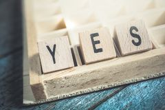 Closeup Of The Word Yes Formed By Wooden Blocks In A Typecase Stock Image