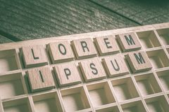 Closeup Of The Words Lorem Ipsum Formed By Wooden Blocks In A Typecase. A Closeup Of The Words Lorem Ipsum Formed By Wooden Blocks In A Typecase royalty free stock images