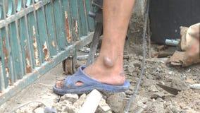 Worker breaking cement floor by using demolition hammer stock footage