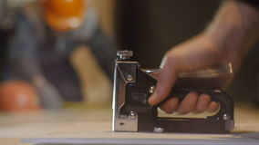 Closeup Worker Nails with Special Modern Hammer stock footage