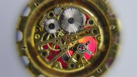 Closeup of working clockwork. Closeup of working clockwork with light effects, selective focus stock footage