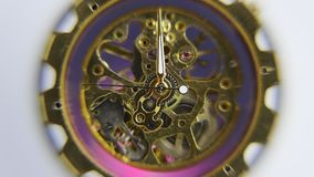 Closeup of working clockwork. Closeup of working clockwork with light effects, selective focus stock video footage