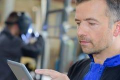 Closeup workman using tablet Royalty Free Stock Image