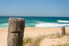 Closeup of fence post at surfing beach on summers day. Closeup of worn fence post at surfing beach on summers day Stock Photography