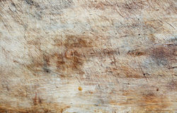 Closeup of a worn wooden cutting board. Royalty Free Stock Photos